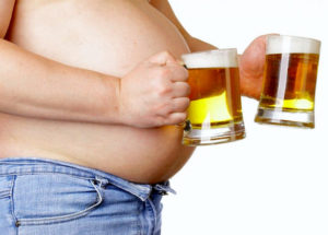 причины появления живота с излишками жира